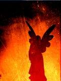 Siluetta di angelo su una struttura del fuoco Fotografia Stock Libera da Diritti