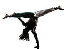 Siluetta di capoeira di dancing del ballerino dell'uomo di colore Immagine Stock