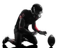 Siluetta di celebrazione di atterraggio del giocatore di football americano Fotografie Stock