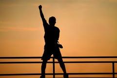 Siluetta di concetto di vittoria dell'uomo Immagini Stock