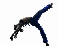 Siluetta di dancing del ballerino di capoeira della donna Fotografia Stock