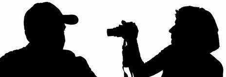Siluetta di giovani accoppiamenti Fotografia Stock