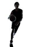 Siluetta di gocciolamento del giocatore di pallacanestro immagine stock