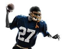 Siluetta di lancio americana dell'uomo del giocatore di football americano dello stratega Fotografia Stock Libera da Diritti