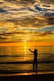 Siluetta di pesca Fotografia Stock