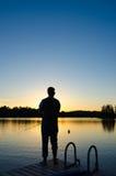Siluetta di pesca Fotografie Stock Libere da Diritti