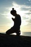 Siluetta di preghiera Fotografia Stock
