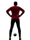Siluetta di retrovisione dell'uomo del portiere del calciatore Fotografie Stock Libere da Diritti