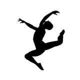 Siluetta di salto del ragazzo Fotografia Stock