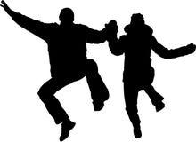 Siluetta di salto delle coppie Fotografia Stock Libera da Diritti