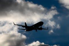 Siluetta di un aeroplano Fotografia Stock