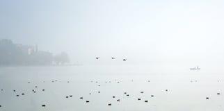Siluetta di un pescatore Fotografia Stock