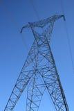 Siluetta di un pilone ad alta tensione di elettricità Fotografie Stock Libere da Diritti