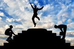 Siluetta di un salto felice dell'uomo d'affari Fotografia Stock Libera da Diritti