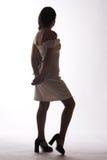 Siluetta di una donna in abito bianco Fotografie Stock