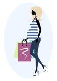 Siluetta di una donna incinta alla moda Immagine Stock Libera da Diritti