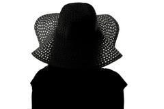 Siluetta di una donna in un cappello Fotografia Stock