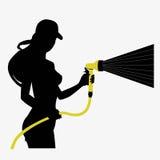 Siluetta di una ragazza con un tubo flessibile Immagine Stock