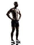 Siluetta diritta del giovane uomo muscolare senza camicia africano di configurazione Immagini Stock