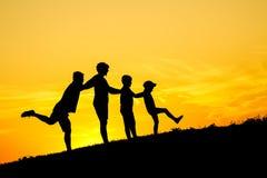 Siluetta felice della famiglia Immagine Stock Libera da Diritti