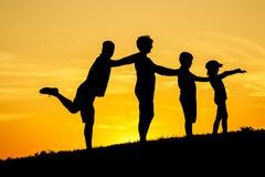 Siluetta felice della famiglia Fotografie Stock Libere da Diritti