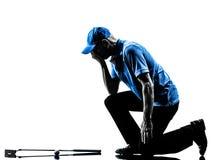 Siluetta golfing del giocatore di golf dell'uomo Fotografia Stock