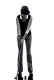 Siluetta golfing del giocatore di golf della donna Fotografia Stock