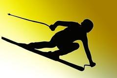 Siluetta posteriore di sport dell'oro - sciatore d'accelerazione Fotografia Stock Libera da Diritti