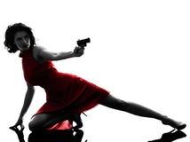 Siluetta della pistola della tenuta della donna Fotografia Stock Libera da Diritti