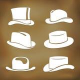 Siluette classiche del cappello degli uomini Fotografia Stock