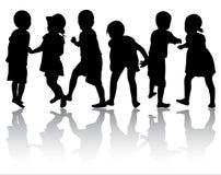 Siluette dei bambini Fotografie Stock