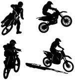 Siluette dei cavalieri del motociclo di sport Fotografie Stock