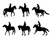 Siluette dei cavallerizzi Immagini Stock