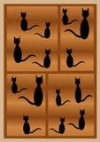 Siluette dei gatti neri Immagini Stock