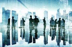 Siluette del concetto della giornata indaffarata degli uomini d'affari Immagine Stock