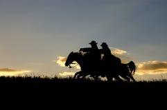 Siluette del cowboy Immagine Stock Libera da Diritti