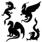 Siluette del drago messe Immagini Stock