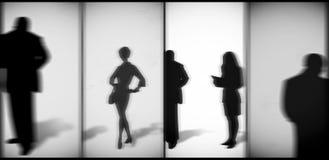 Siluette della gente con le ombre Fotografia Stock