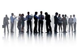 Siluette della gente di affari corporativa di lavoro immagini stock