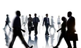 Siluette della gente di affari di ora di punta Fotografia Stock