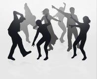 Siluette della gente di dancing Fotografie Stock Libere da Diritti