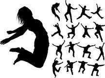 Siluette della gente di salto Fotografia Stock Libera da Diritti