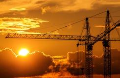 Siluette delle gru della costruzione Immagini Stock