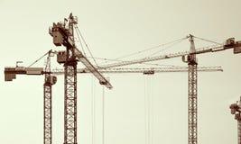 Siluette delle gru di costruzione Immagine Stock Libera da Diritti