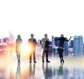 Siluette delle persone di affari con luce solare Fotografia Stock Libera da Diritti
