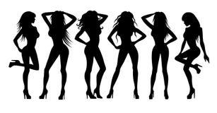 Siluette delle ragazze su bianco Immagine Stock