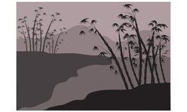 Siluette di bambù sul fiume Fotografie Stock