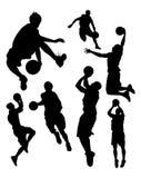 Siluette di pallacanestro Fotografia Stock