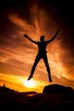 Siluette di salto Fotografia Stock