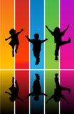 Siluette di salto dei bambini Fotografie Stock Libere da Diritti
